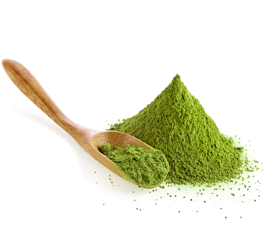 Green Powder and wooden spoon
