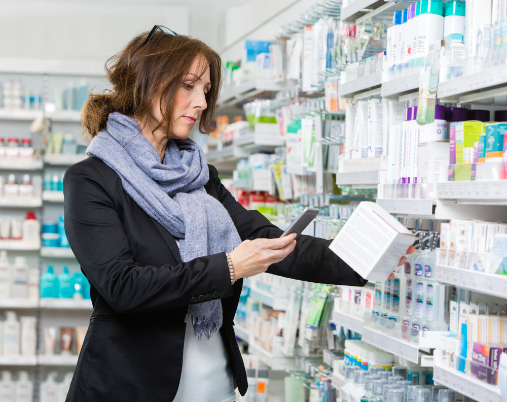 Customer Scanning Product Through Mobile Phone In Pharmacy